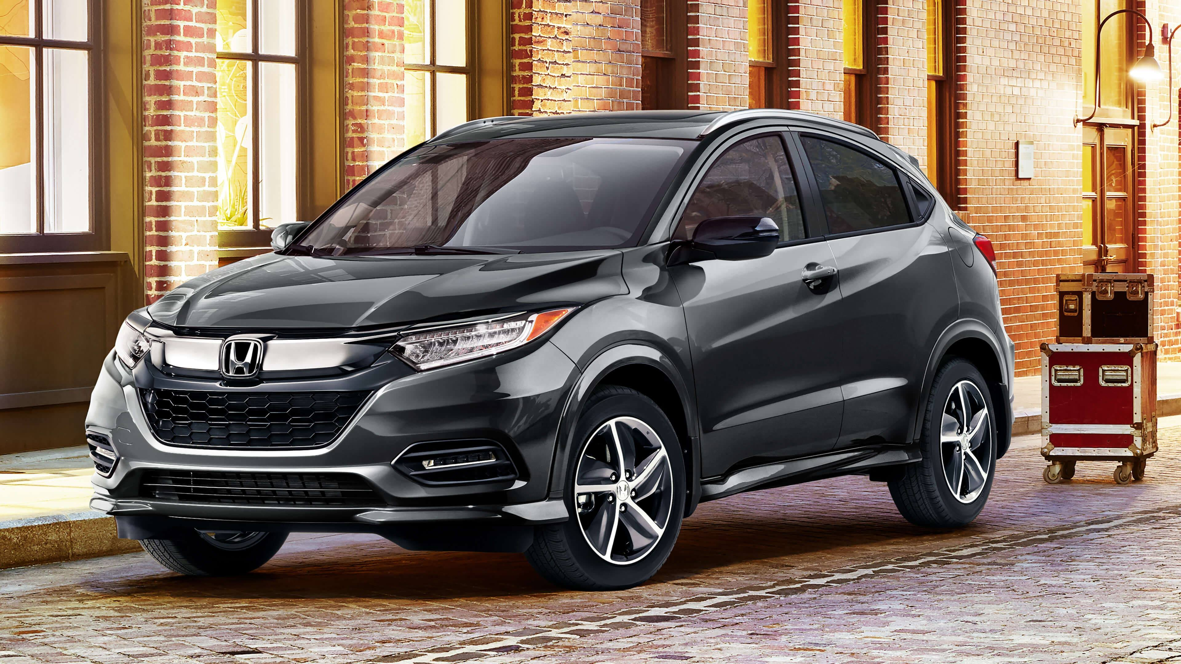 Diagonal front view of 2020 Honda HR-V parked in front of a brick building