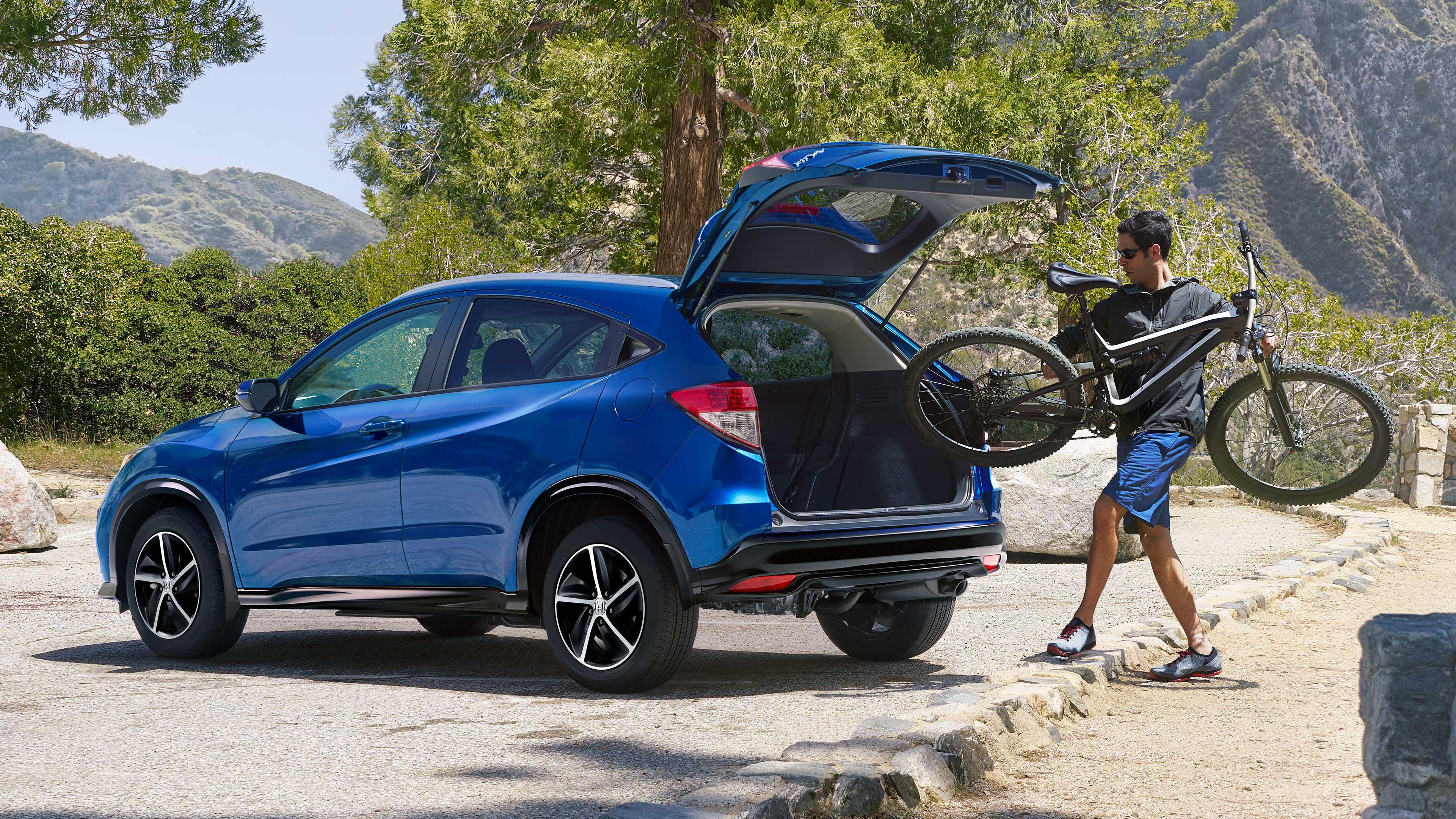 Man loading a bike into the back of a 2020 Honda HR-V