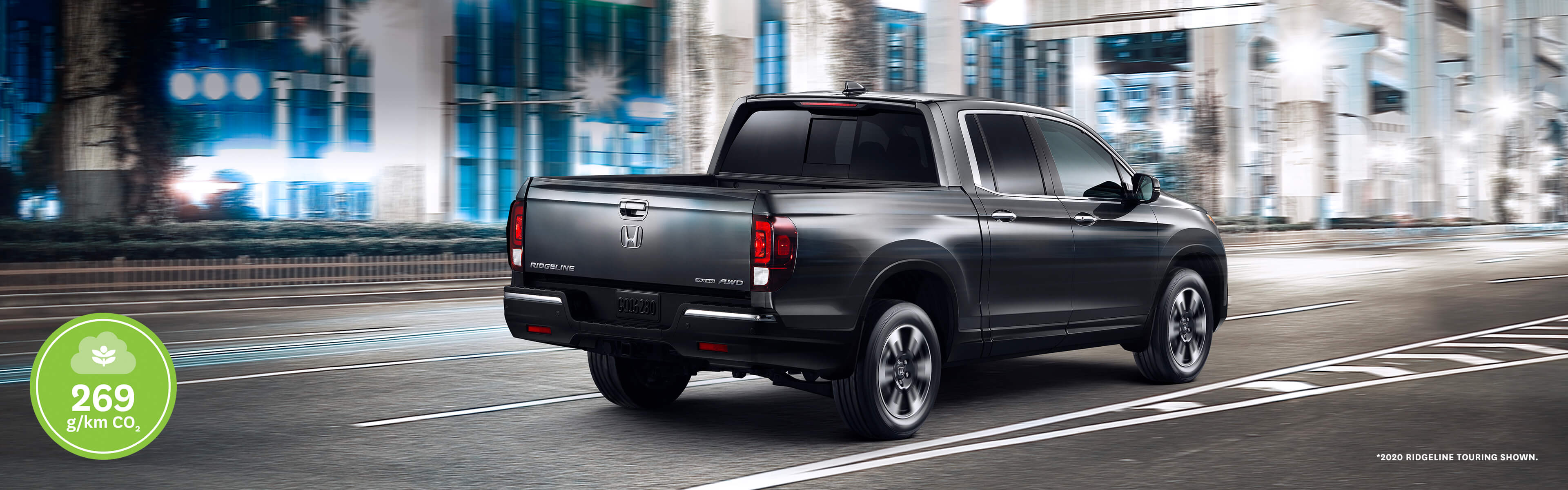 Rear of 2020 Honda Ridgeline driving in the city at night