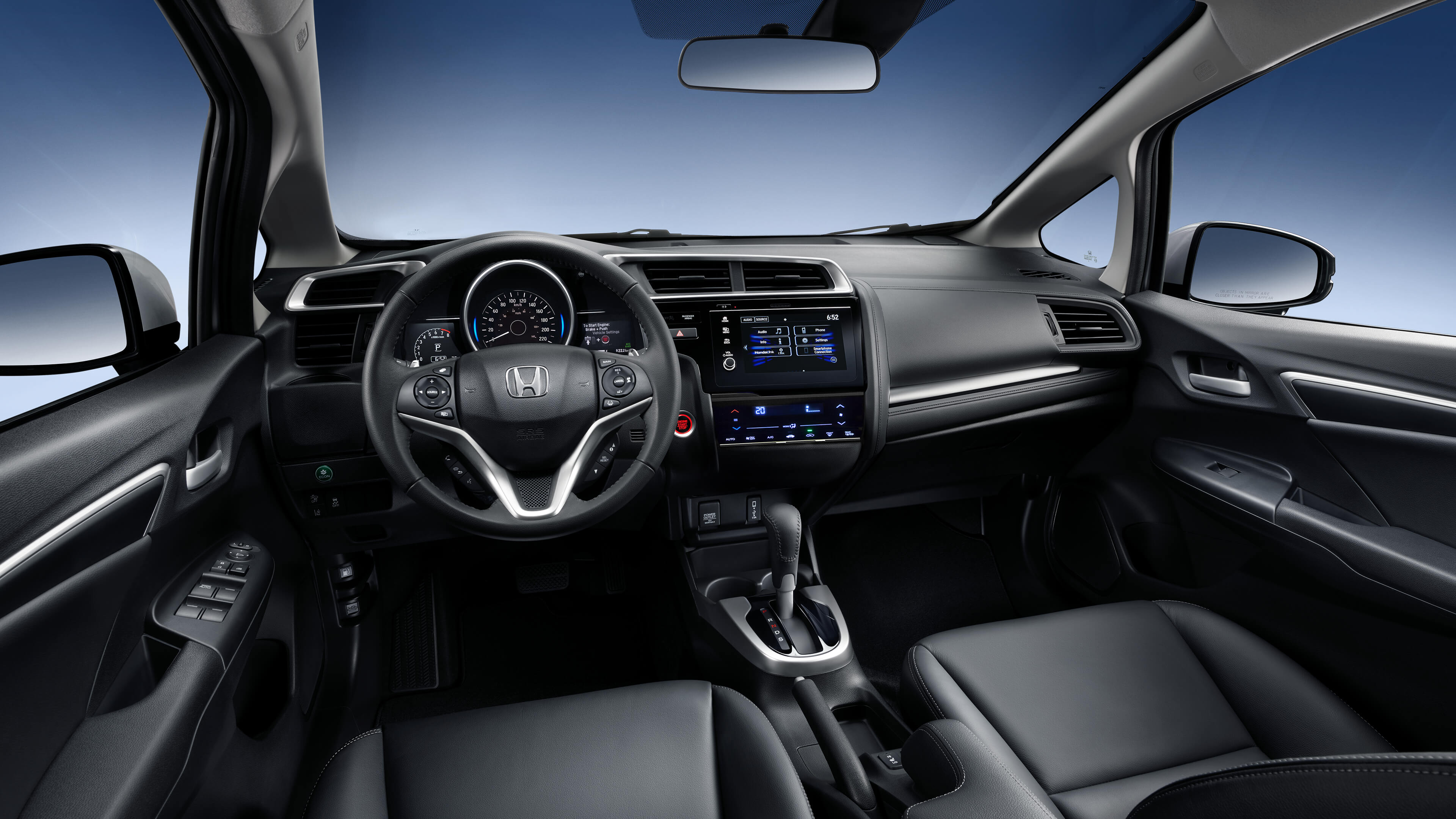 Front interior of the Fit with seats, steering wheel and dashboard