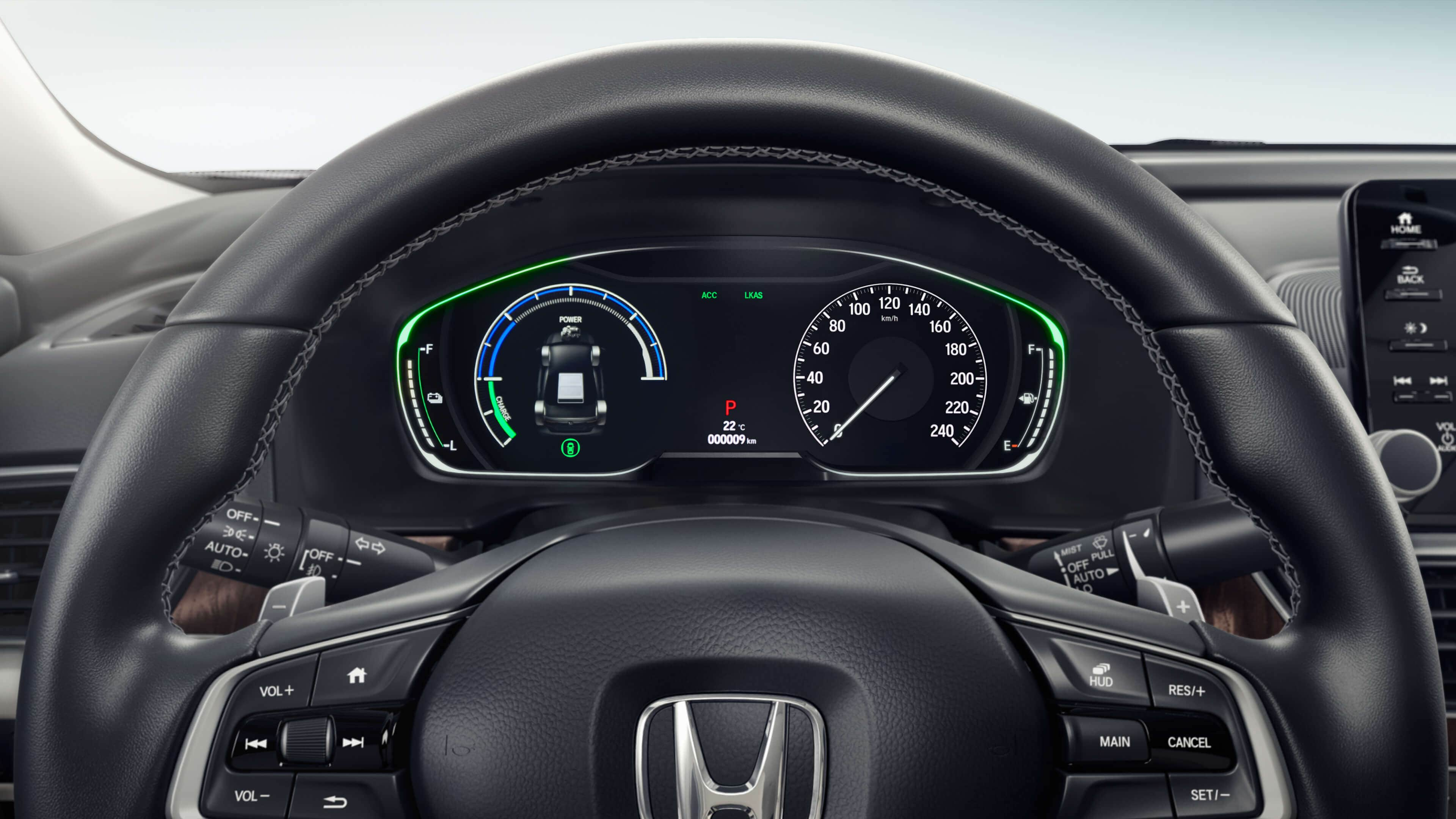 Straight on view of steering wheel and dashboard