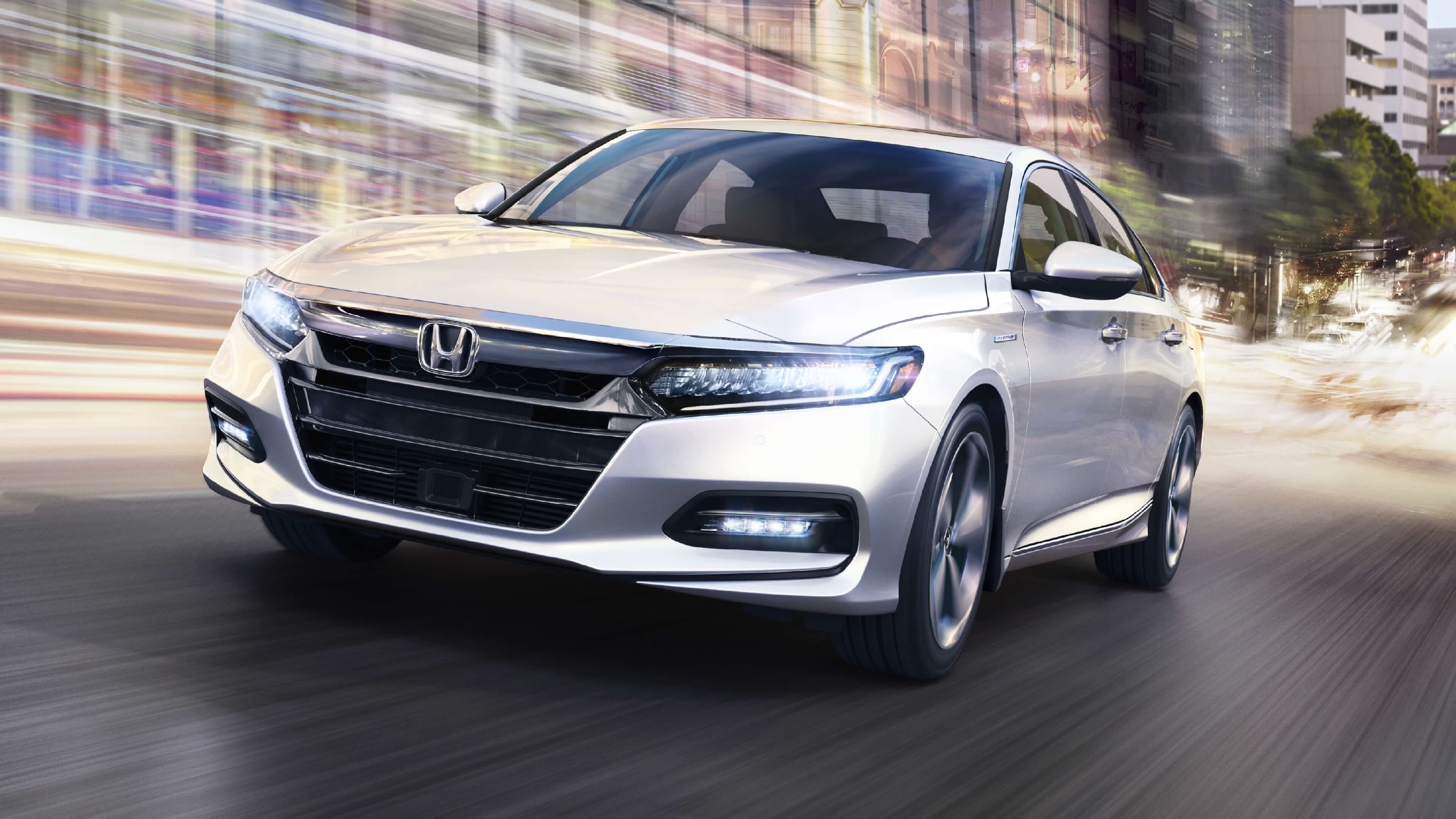 Accord Hybrid driving with futuristic effects around it