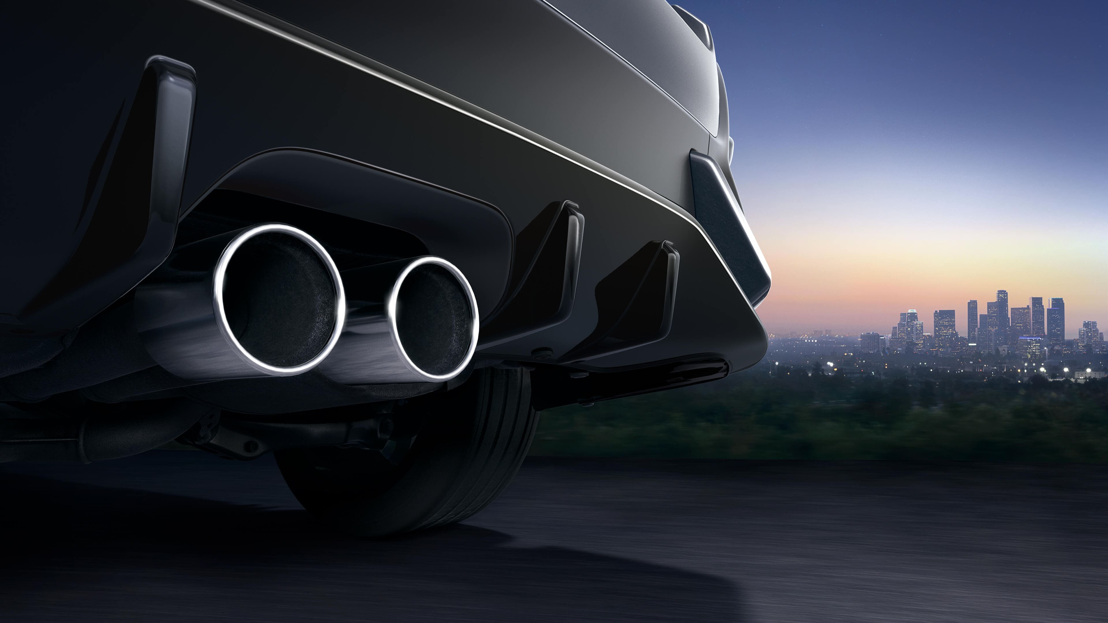 Exhaust of Civic Hatchback with city in background